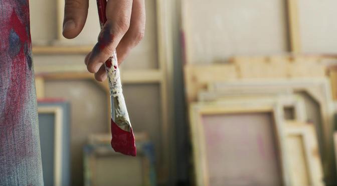 Artist's Hand Holding Paintbrush